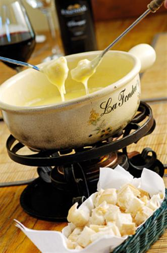 Melt the cold away with Swiss Cheese Fondue at Eikendal Vineyards